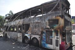 Bangkok/Thailand - 12 02 2013: A bus and two vans got set on fire on Ramkhamhaeng road.  Stock Image