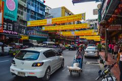 Bangkok, Thailand - november 15, 2016: busy rush hour city street with lots of signs and banners in the background, chinatown, tuk royalty free stock images