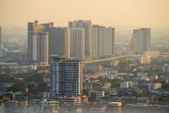 Air pollution in the city. Bangkok Thailand Center and modern skyscraper city in misty gold lighting sunset air pollution in the city behind pollution haze stock photos