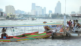 Bangkok Thailand Chao Phraya River Dock. BANGKOK, THAILAND - OCTOBER 27, 2014: Daily life on the Chao Phraya River features a busy circling of colorful boats on stock video footage