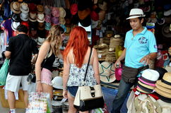 Bangkok, Thailand: Chatuchak Market. Two Australian women check out bargain priced hats from a vendor's booth at the famed Chatuchak weekend market in Bangkok Stock Photo