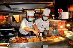 Bangkok, Thailand: Chefs Cookling Sausages Royalty Free Stock Image