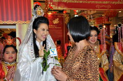 Bangkok, Thailand: Chinese New Year Event. A TV reporter interviews woman dressed as a Guan Yin Buddha following the Central World shopping mall Chinese New Year Royalty Free Stock Photos