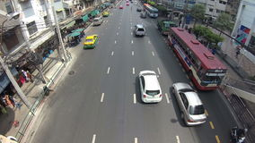 BANGKOK, THAILAND - CIRCA March 2017: City traffic, cars, mopeds, busses passing by. Action camera stock video