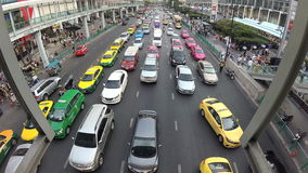 BANGKOK, THAILAND - CIRCA March 2017: City traffic jam, cars, mopeds, busses, taxis. Action camera stock video footage