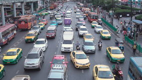 BANGKOK, THAILAND - CIRCA March 2017: City traffic jam, cars, mopeds, busses, taxis stock footage