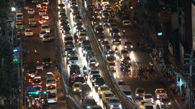 BANGKOK, THAILAND - CIRCA March 2017: Cityscape skyline at night. Traffic rush hour cars moving stock footage