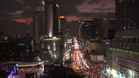 BANGKOK, THAILAND - CIRCA March 2017: Cityscape skyline at night. Traffic rush hour cars moving stock video footage