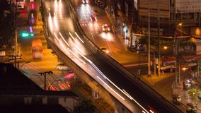 BANGKOK, THAILAND-CIRCA March 2017: Timelapse of Bangkok at night. Traffic on busy road at rush hour. BANGKOK, THAILAND - CIRCA March 2017: Cityscape timelapse stock video footage