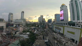BANGKOK, THAILAND - CIRCA March 2017: Wide angle timelapse of the sunset in the city. Action camera stock footage