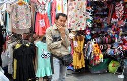 Bangkok, Thailand: Clothing Seller at Outdoor Market Stock Images