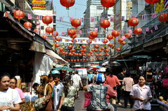 Bangkok, Thailand: Colourful Chinatown. Hundreds of red Chinese lanterns hang over a bustling street in the heart of Bangkok, Thailand's Chinatown district Royalty Free Stock Images