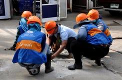 Bangkok, Thailand: Construction Workers with Orange Helmets Stock Photo