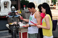 Bangkok, Thailand: Couple Lighting Incense Sticks Stock Images