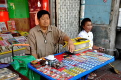 Bangkok, Thailand: Couple Selling Batteries in Chinatown Stock Image