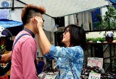 Bangkok, Thailand: Couple Shopping on Silom Road Royalty Free Stock Photography