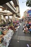 Bangkok/Thailand - 01 14 2014: De gula skjortorna blockerar och upptar Pathum den glåmiga korsningen som delen av operationen för Royaltyfria Bilder