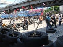 Bangkok/Thailand - 04 30 2010: De rode Overhemden zetten barricades en blok hoofdgebieden rond Centraal Bangkok op royalty-vrije stock afbeelding