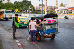 BANGKOK,THAILAND DEC 12: Chinese tourists are get up on tuk-tuk. For sightseeing on DECEMBER 12, 2014 in Bangkok, Thailand Royalty Free Stock Photography