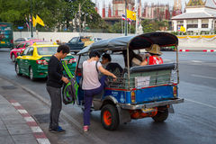 BANGKOK,THAILAND DEC 12: Chinese tourists are get up on tuk-tuk. For sightseeing on DECEMBER 12, 2014 in Bangkok, Thailand Stock Photography