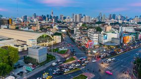 Day to night time lapse of traffic at Hua Lamphong intersection and Hua Lamphong railway station in Bangkok, Thailand stock footage