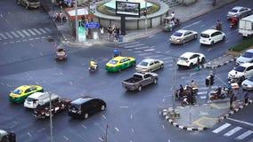 Slow-motion of traffic at Hua Lamphong intersection in Bangkok, Thailand stock video