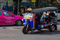 BANGKOK,THAILAND DEC 12: Tourists take tuk-tuk for convenience s. Ightseeing on DECEMBER 12, 2014 in Bangkok, Thailand Stock Photography