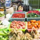 BANGKOK, THAILAND - DEC 15, 2014: Unidentified girl child seller on the Burmese street market in Bangkok. Stock Image