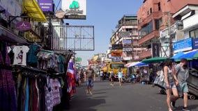 BANGKOK, THAILAND - December 23 2017: Backpackers and Tourists walk on Khao San Road in Bangkok, Thailand. Khao San Road stock video footage