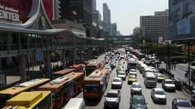 BANGKOK, THAILAND - 18 DECEMBER, 2018: Cars on busy city street. Many modern cars and buses riding on busy street on stock video