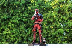 Close up shot of Deadpool superheros figure in action holding unicorn ,model figure 1/6 scale royalty free stock photo
