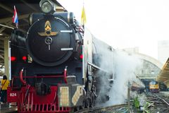 Bangkok,Thailand:December 5, 2018 - Closeup vintage steam train. Locomotive parking at the station waiting for departing. Landscape of State Railway of Thailand royalty free stock image