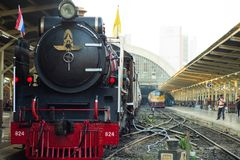 Bangkok,Thailand:December 5, 2018 - Closeup vintage steam train. Locomotive parking at the station with driver waiting for departing. Landscape of State Railway stock photo