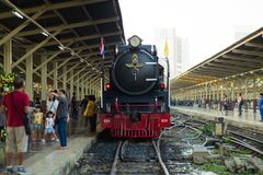 Bangkok,Thailand:December 5, 2018 - Closeup vintage steam train. Parking at the station waiting for departing. Crowd of people taking the picture with the train royalty free stock photography