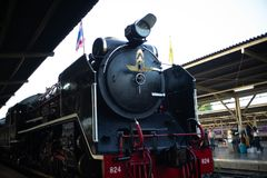 Bangkok,Thailand:December 5, 2018 - Closeup vintage steam train. Locomotive parking at the station waiting for departing. Landscape of State Railway of Thailand royalty free stock photography
