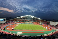Bangkok , Thailand - December 8 ,2016 : Crowd of people in Rajamangala national football stadium of Thailand against colorful twil. Ight sky before match Stock Images