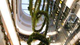 BANGKOK, THAILAND - 18 DECEMBER, 2018 The Emquartier luxury shopping center. Design of mall, green environmentally. Friendly concept. hanging garden, futuristic stock video footage