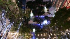 BANGKOK, THAILAND - 18 DECEMBER, 2018 The Emquartier - luxury shopping center. Design of mall in green environmentally. Friendly concept. Open air hanging stock video