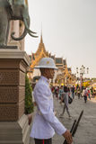 BANGKOK, THAILAND - DECEMBER 24: The Grand Palace in Bangkok, Thailand on December 24, 2014. Unidentified royal guard is on duty a Royalty Free Stock Photos