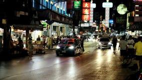 Bangkok thailand - december1,2018 : large number of people walking on yaowarat street one of most popular street food in chinatown stock video