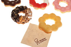 BANGKOK THAILAND - DECEMBER 11 :  Many Pon De Rings donuts of mister donuts brand with napkin on white background in BANGKOK THAIL. Mister Donuts brand offering Stock Photography