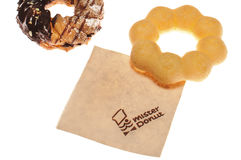 BANGKOK THAILAND - DECEMBER 11 :  Many Pon De Rings donuts of mister donuts brand with napkin on white background in BANGKOK THAIL. Mister Donuts brand offering Royalty Free Stock Photography