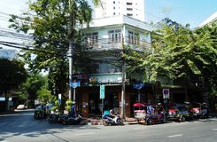 Motorbikes and iconic tuk tuk in front of coffee shop stock photos