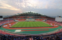 Bangkok , Thailand - December 8 ,2016 : Panoramic view of Rajamangala stadium with unidentified supporters before match to night a. Gainst colorful twilight sky Royalty Free Stock Photo