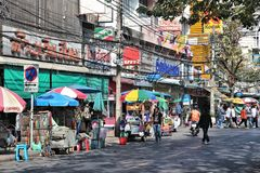 Bangkok city life. BANGKOK, THAILAND - DECEMBER 22, 2013: People drive visit hectic streets of Bangkok. Bangkok is the biggest city in Thailand with 14 million Stock Photo