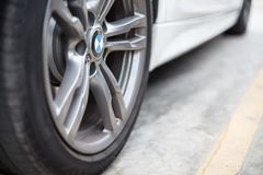 Selective focus of BMW brand wheels on the parking lot background