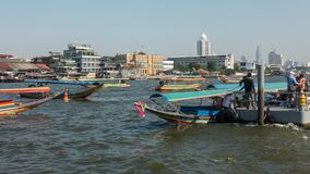 BANGKOK, THAILAND - December 22, 2017: Timelapse view of movement of boats on Chao Phraya River, Bangkok, Thailand. Colourful traditional wooden boats stock video