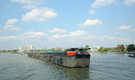 Traditional barges on Chao Phraya river Royalty Free Stock Photos
