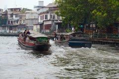 Two passenger route boats on the Mahanak kanal klong. Bangkok