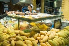 BANGKOK, THAILAND - December 26, 2017: Undefined asian seller sells mango dishes in a shopping mall Terminal 21 in Bangkok. Thailand Stock Image